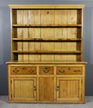 A 19th Century stripped pine kitchen dresser, the upper part with moulded c