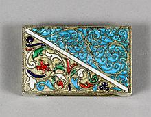 An early 20th Century Russian silver gilt and enamel rectangular matchbox cover decorated with vario