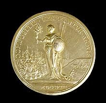 A Queen Anne silver gilt medallion commemorating the end of Queen Anne's War (1702-1713) following t
