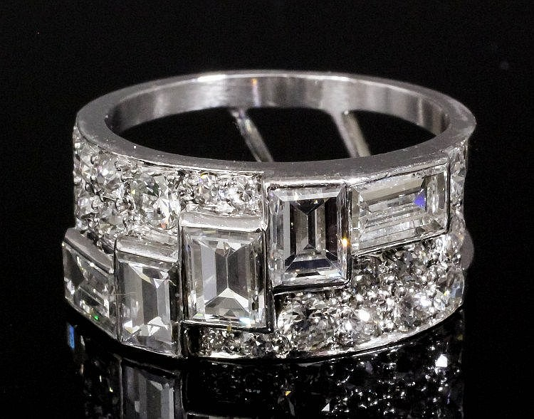 An Art Deco platinum mounted all diamond set dress