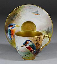 An early 20th Century Royal Worcester bone china cabinet cup and saucer enamelled in colours with a