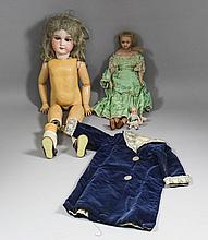 An Armand Marseilles bisque headed doll with blue closing eyes, open mouth and composition body, 23.