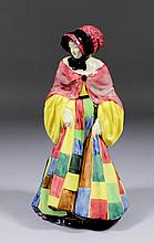 Four Royal Doulton pottery figures -