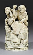A Japanese carved ivory Okimono of four feuding
