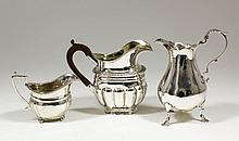 A William IV silver baluster shaped cream jug with