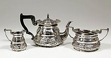 An Edward VII silver circular three piece tea