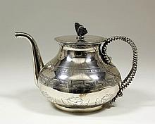 A Victorian silver teapot, the bulbous body