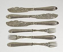 A set of twelve Victorian silver fish knives and