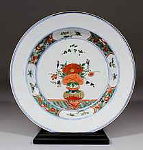 A Chinese porcelain plate painted in the