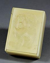 A Japanese ivory rectangular box, the lid carved