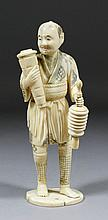 A Japanese carved ivory standing figure of a man