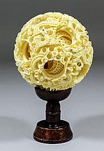 A Chinese fourteen layer ivory puzzle ball carved
