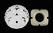 A Chinese jade circular disc carved with