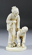 A 19th Century Japanese carved ivory figural group