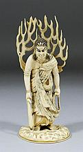 A Japanese carved ivory standing figure of a