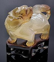 A Chinese agate standing figure of a kylin,