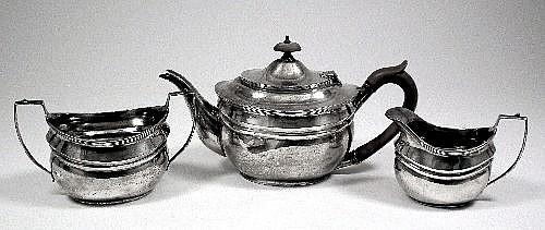 An Edward VIII silver three piece tea service of