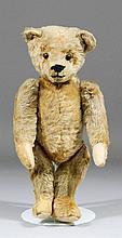 A 1910 small Steiff blond mohair teddy bear with b