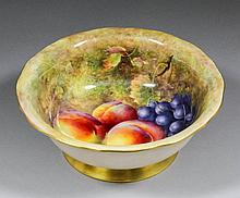 A Royal Worcester bone china bowl painted by Richa