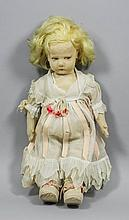 An early 20th Century felt doll with blond wig and
