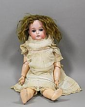 A Simon & Halbig (K&R;) bisque headed doll with clo