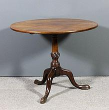 A George III mahogany circular tripod table with p
