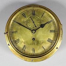 A polished brass cased ship's bulkhead timepiece,