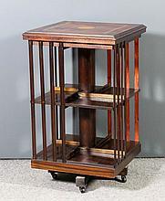 A mahogany square two tier revolving case in the E