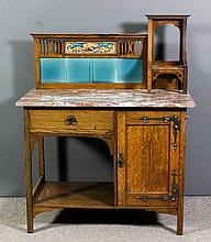 A late Victorian oak washstand in the Arts & Craft