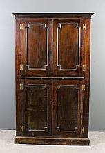 An mahogany two tier corner cupboard, the upper pa