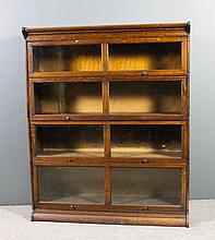 An oak four tier sectional bookcase in the