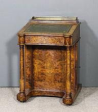 A Victorian figured walnut Davenport inlaid with b