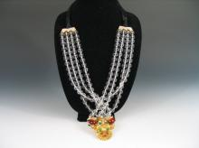 CRYSTAL GLASS NECKLACE WITH METAL PENDANT DECORATED