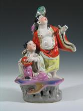 Chinese Famille Rose Porcelain Figure of Woman and Child.
