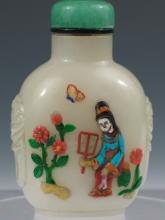 Chinese White Jade Snuff Bottle with Soapstone Decoration, Qing Dynasty.