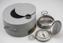 Two Pocket Watch Cases and a Pocket Compass