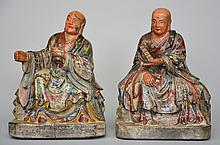 Two Oriental polychromed wooden Buddhist monks, ca. 1900, H 31 - 32 cm (damage to the polychrome)