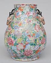 An exceptional Chinese mille-fleurs Hu-vase, decorated with deer heads, marked Qianlong, 19thC, H 33 cm (the deer decoration with restoration)