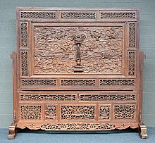 An impressive Chinese wooden chamber screen with richly carved dragons relief decorations, H 211,5 - W 221 - D 58 cm
