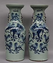 A pair of Chinese celadon vases with blue and white decorated kylins, 19thC, H 60 cm