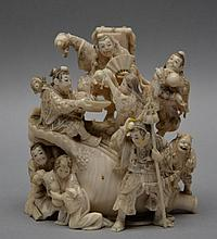 A small, fine, Chinese ivory carved group with nine figures, signed on the bottom, ca. 1900, H 9 cm