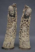 A pair of Chinese ivory carved figures, first half of 20thC, H 37 - H 36 cm