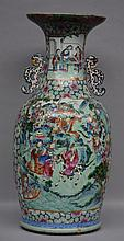 An impressive celadon vase, polychrome decorated with warrior scenes, 19thC, H 83,5 cm (chips on the rim)