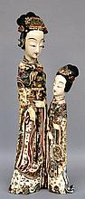 Two Chinese polychrome ivory carved figures (attached to each other), first half 20thC, H 48,5 cm