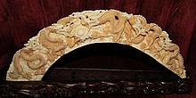 Ivory Scultpture of Dragons on wood base,signed.