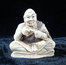 Old  Ivory Netsuke Man Eating  H-2