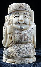 Old Ivory sculpture Man w/green ,red robe signed