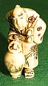 Ivory  Netsuke, Man with Amphora, signed