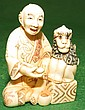 Ivory  Netsuke, Man with Monkey, signed
