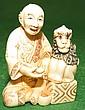 Ivory  Netsuke, Man with Monkey, signed